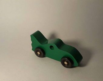 Handcrafted Play Pals Wood Toy Bat Car.