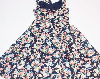 Rockabilly background dress and blue details with floral pattern