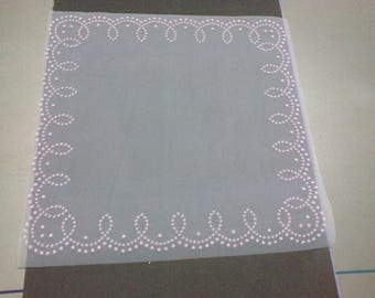 Four squares of white tulle stitched roses pattern on the edges