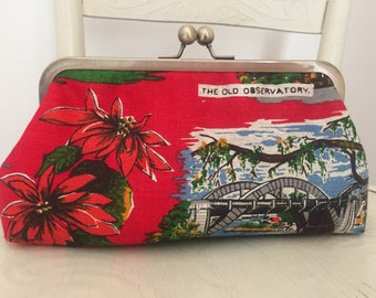 Handmade clutch from vintage Australian linen with scenes of Brisbane and a kisslock frame