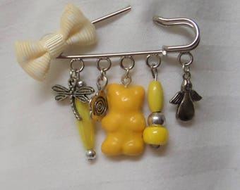 Brooch pin safety gourmet, beads, charms and yellow candy