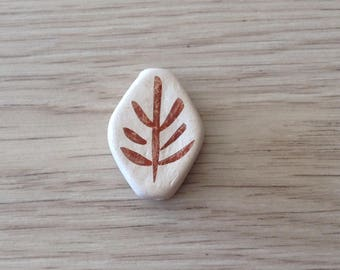 White clay hand shaped ceramic bead