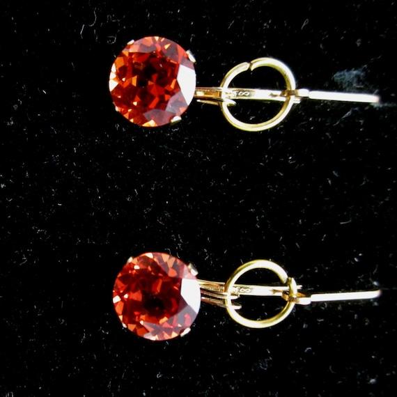 Earrings J, Padparadsha Sapphire, gold leverbacks 21ct