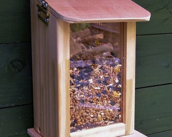 Wild squirrel feeder for your garden help feed the squirrels. Stop them from pinching bird food.