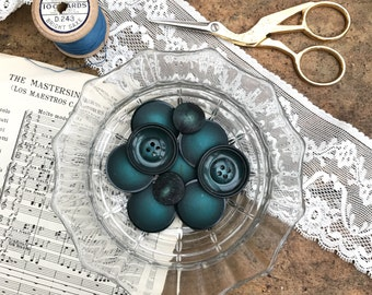 A mixed set of various vintage teal buttons