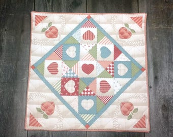 vintage fabric peach hearts hand quilted table mat, center piece, wall hanging    you decide its use!