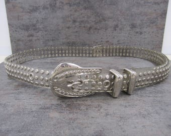 Clear studded belt with silver buckle and embellishments