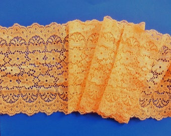 D 32 - Wide lace patterned floral yellow.