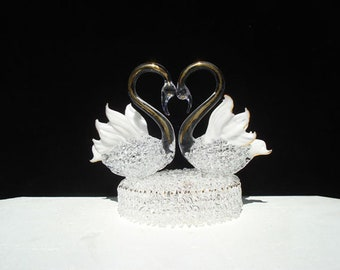 Swan wedding cake topper with two swans on a base