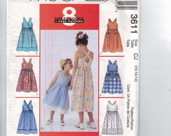 Sewing Pattern McCalls 3611 Childs Girls Sundress Pockets Crossed Back Surplice Bodie Sleeveless Size 10 12 14 Breast 28 30 32 UNCUT