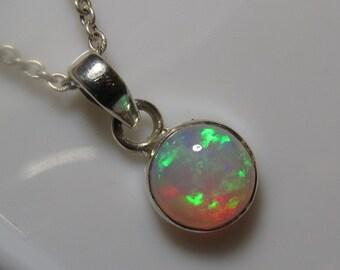Welo opal pendant etsy welo ethiopian opal round shape pendant amazing fire pendant bezel setting pendant so nice mozeypictures Gallery