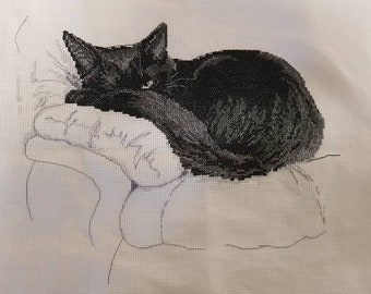 Beautiful sleepy black and white cat completed cross stitch