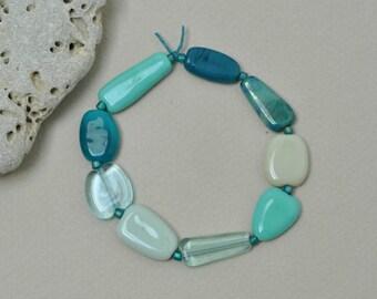 Wet sea glass pebbles, I - Artisan lampwork beads by Loupiac