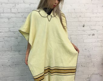 vintage ecru knit poncho / pale yellow striped cape / hippie boho blanket sweater / western mexican poncho with fringe