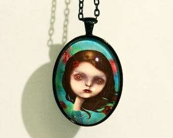 "Oval necklace with print of dreamy girl ""Morpheus' garden"", art by Susann Brox Nilsen. Surrealism, cartoon, red poppy flowers, for her"