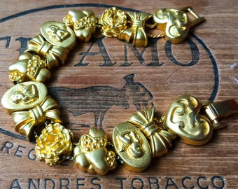 Beautiful Vintage Charm Bracelet with a rich Gold Plating