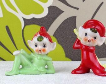 Paire de figurines elf en céramique vintage effronté.