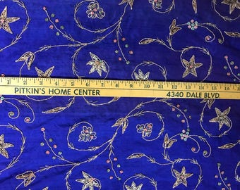 Royal blue dupioni silk with gold embroidery accented with beads