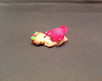 polymer clay with a Fuchsia dress baby