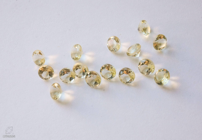 5mm lemon quartz faceted gemstone. light yellow gem. round gem