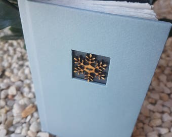 White journal with wooden snowflake button