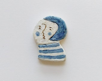 Bobbed and clay brooch