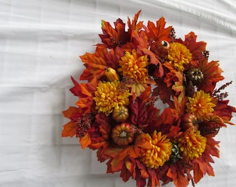 Bright maple orange wreath:  faux-silk-artificial flowers and leaves; fall-autumn grapevine wreath; pumpkins and squash