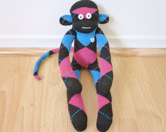 Argyle sock monkey plush doll - blue, magenta, and black with red heart