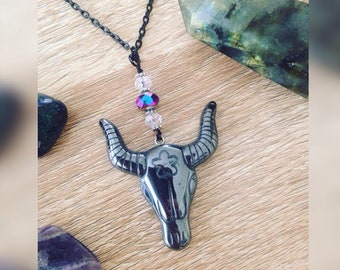 Carved hematite bull head pendant necklace