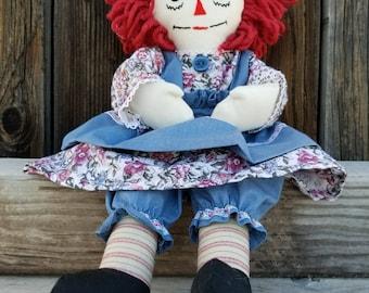 Handmade Raggedy Ann Doll with blue apron.