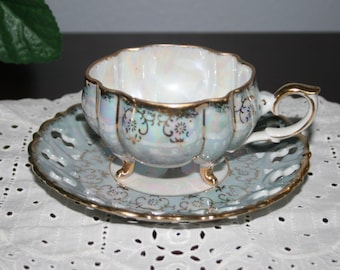 Vintage Iridescent Cup and Saucer Trimmed in Gold Gilt