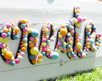 """36"""" wall letters embellished with handmade wool felt balls"""