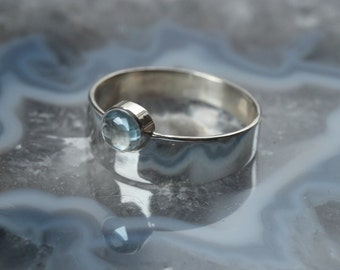 Sterling Silver ring with blue Topaz
