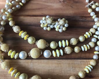 Dreamy vintage yellow multi strand beaded necklace with clip on earrings.