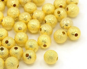 Wholesale lot of 100 Golden stardust (copper plated) 8mm beads