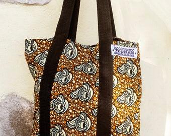 An original brown and black African Wax print hand bag