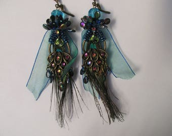 "Earrings ""Collection Peacock"" on a connector ""Peacock tail"" with ""pip"" Czech glass beads and real peacock feathers"