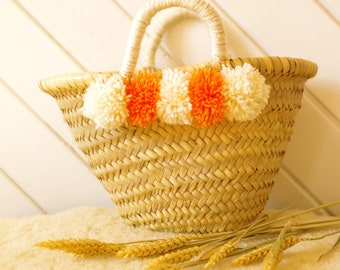 Wicker basket with wool tassels