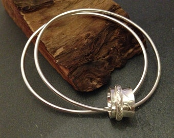 Sterling silver bangles with spinner ring, hallmarked in Edinburgh