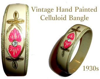 Celluloid Bangle - Cream with  Carved Pink and Gold Painted Design, and Clear Stones. Art Deco Flapper Bangle. 1930s.