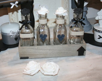 in a wooden home box bud vases