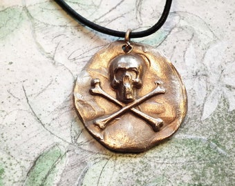 Steampunk gothic pirate pendant ; golden Bronze  skull . You'll find it in white bronze  or copper in this shop