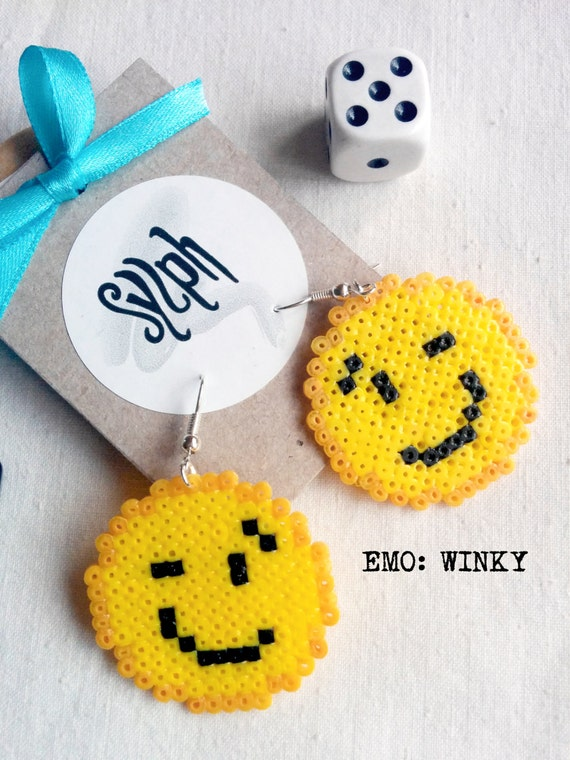 Winky smile emoticon earrings in 8bit retro style showing off that quirky half smile you've got going on, made out of Hama Mini Perler beads