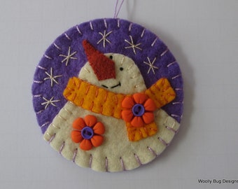 Wool Felt Snowman, Lilac Purple Background, Bright Yellow Scarf, Orange Flower Buttons, Handstitched Snowflakes