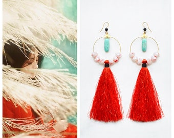 CGC030 - Asian inspired modern ethnic gold earrings with teal amazonite and black lava stones, white and red crystals and red tassels.