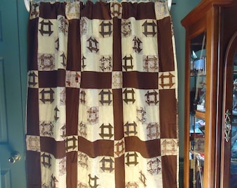 "Churn Dash Quilt      58"" x 75""        Brown and tan in color"