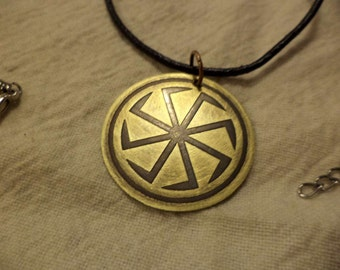Etched brass Viking Sun Wheel pendant