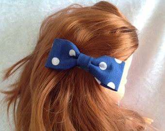 Hair clip blue clap has white dots