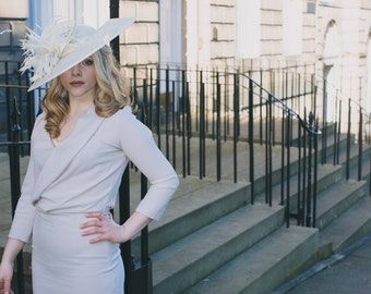 Ivory sinamay asymmetrical hat perfect for wedding or derby/race event