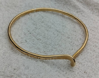 Hand stamped brass bangle.    jewelrybyjohndesign